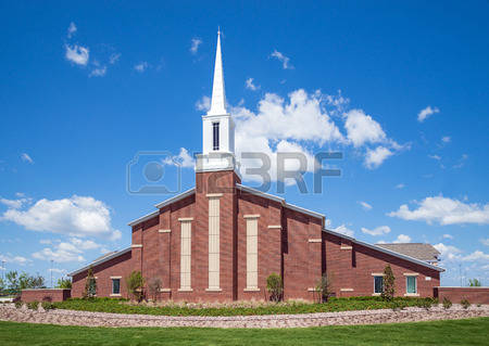 28420047-mormon-church-against-blue-sky-with-white-clouds
