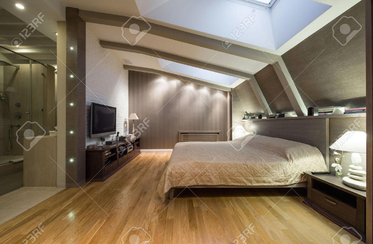 47931499-Loft-bedroom-with-private-bathroom-Stock-Photo-bedroom-room
